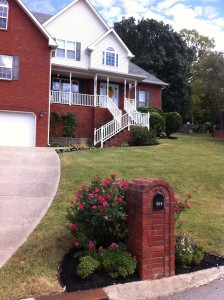Pansies, black mulch, and elbow grease make this front yard shine!